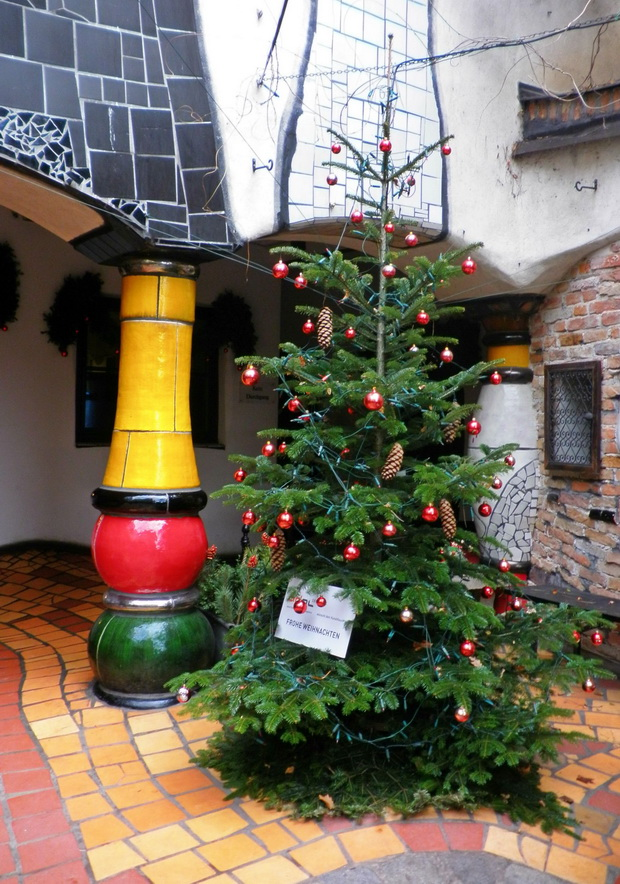 Christmas tree with red ornaments,museum hundertwasser kunsthaus wien,museums in vienna,famous colorful architecture hundertwasser photo,december holiday travel ideas,