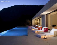 colorful outdoor lounge chairs,designer furniture brands,poolside furniture ideas,swimming pool house design images,romantic setting by the pool,