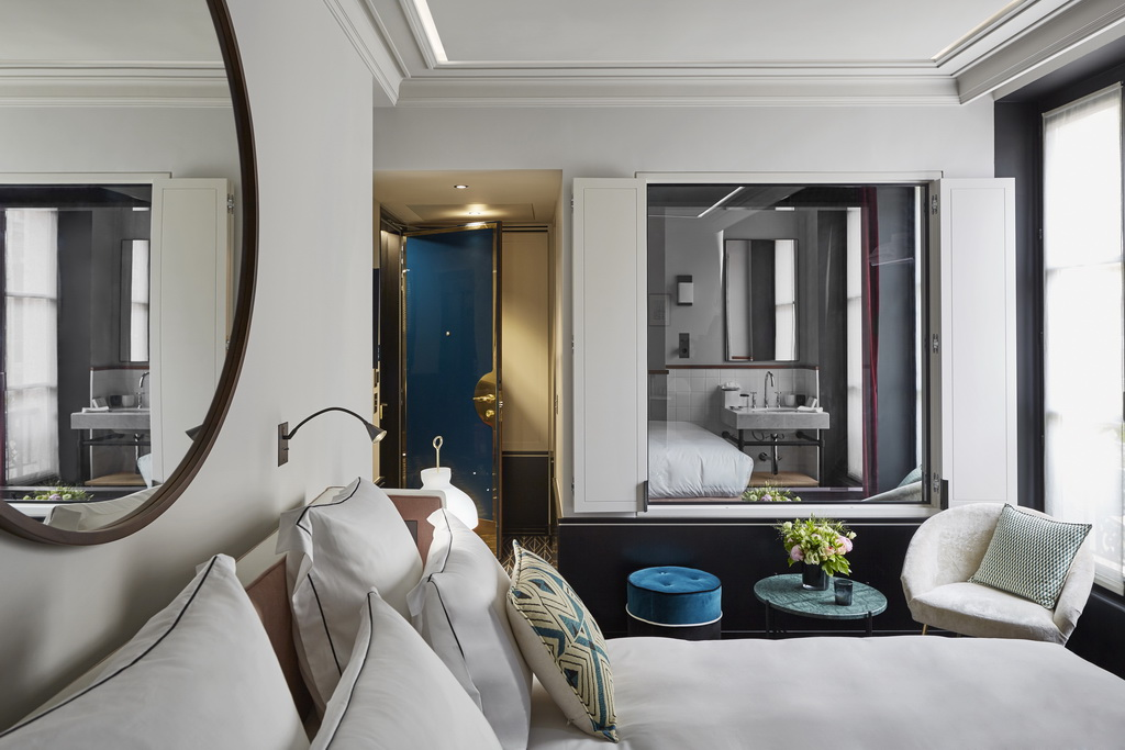 stylish hotel rooms paris france,le roch hotel paris rooms,white and black hotel walls bedroom,hotel bedroom with window to the bathroom,blue green white bedroom ideas,