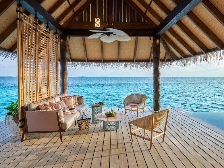 joali maldives sunset water villa,basket chair outdoor,outdoor living room by the sea,designer outdoor furniture ideas,muravandhoo island raa atoll,