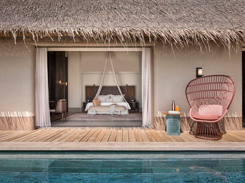 three bedroom luxury villas maldives,hotel rooms with a private pool,joali maldives ocean resort & spa,wooden bedroom wall decor,luxury bedroom design,