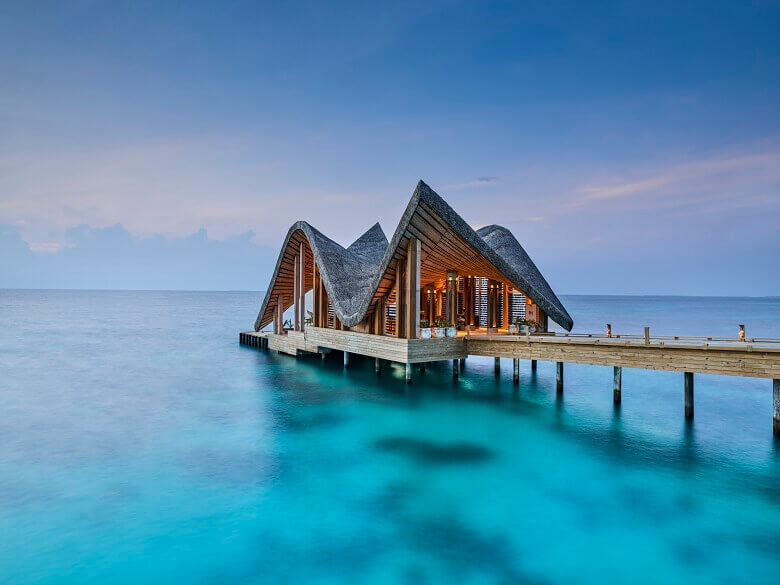creative roofing designs solutions,house above the sea,joali maldives jetty architecture,luxury tropical holidays,resort architecture project,