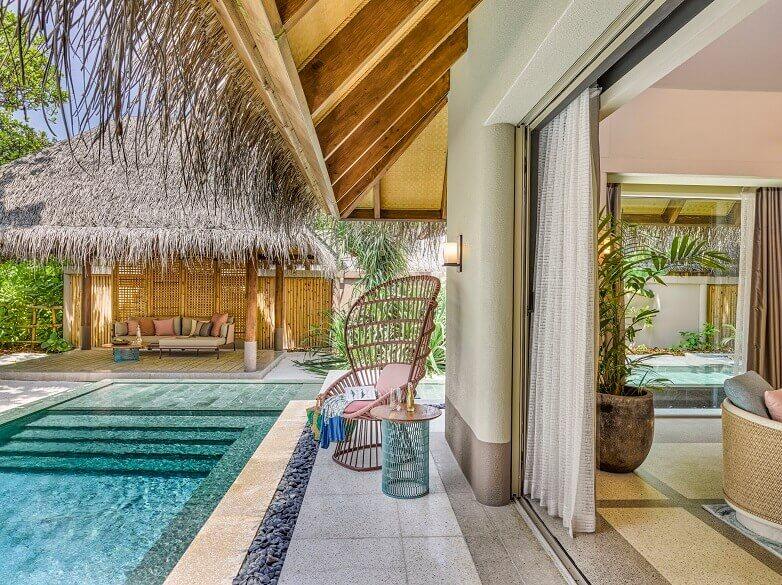 luxury hotel villa architecture,tropical outdoor design ideas,joali maldives beach villa,kettal furniture outdoor,best tropical honeymoon destinations,
