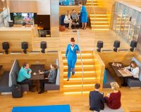 amsterdam airport hospitality,airport cafe design,couple talking to each other,klm lounge amsterdam airport,airplane travel tips for long flights,