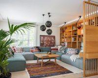 blue corner sofa living room,wooden sliding door design for living room,turkish kilim rug,interior designer project in istanbul,living room with wooden furniture,