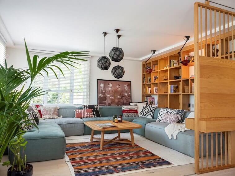 interior designer project in istanbul,living room with wooden furniture,blue corner sofa living room,turkish kilim rug,wooden sliding door design for living room,