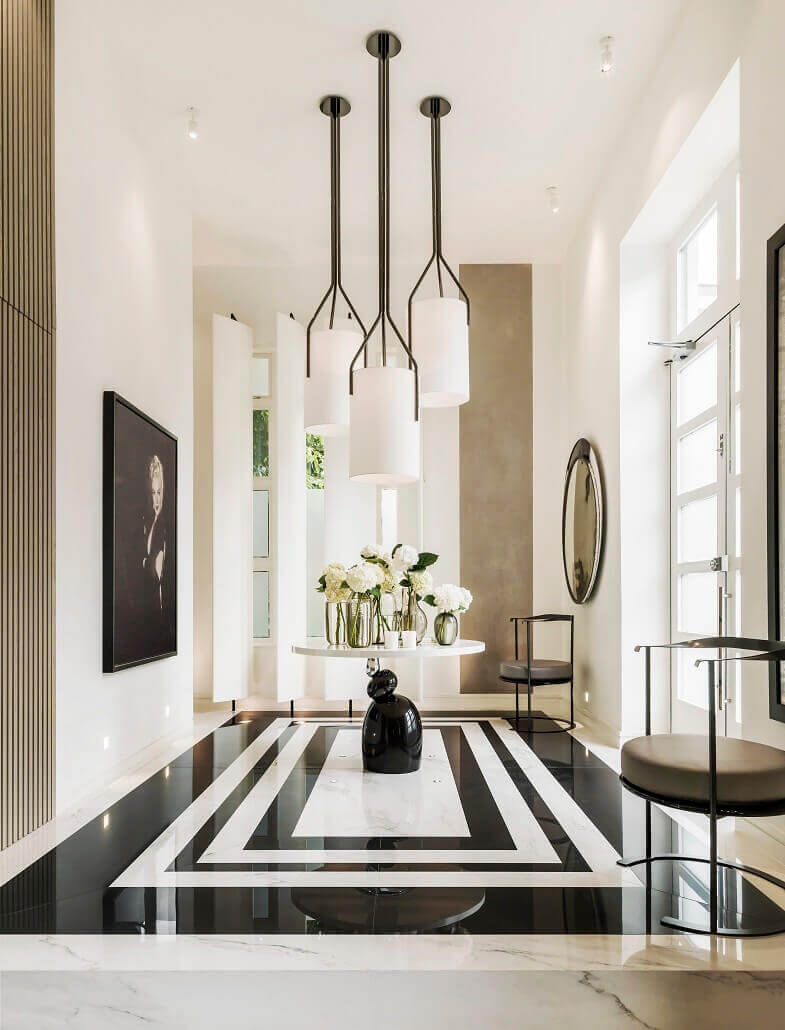 kelly hoppen home interiors,luxury home entrance designs,white and black flooring,flowers in the lobby,designer lobby furniture,