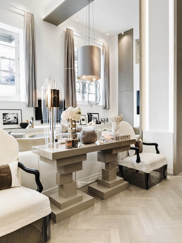 modern living room console table,designer console tables contemporary,neutral tone luxury home decor,kelly hoppen living room ideas,white designer armchair,