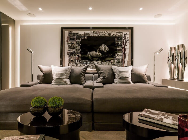 kelly hoppen london house,tv room design ideas,large sofa in small living room,lion photo wall art,modern design tv room,