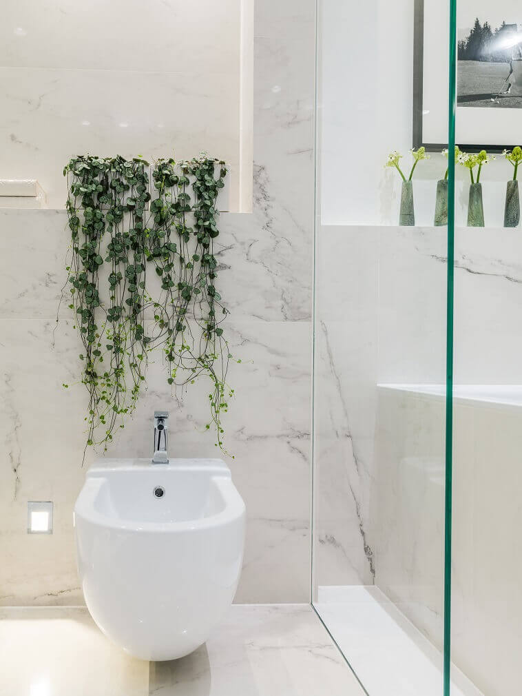 nature in your bathroom,green plants for bathrooms,white and green nature design,white marble bathroom wall ideas,modern bidet design,
