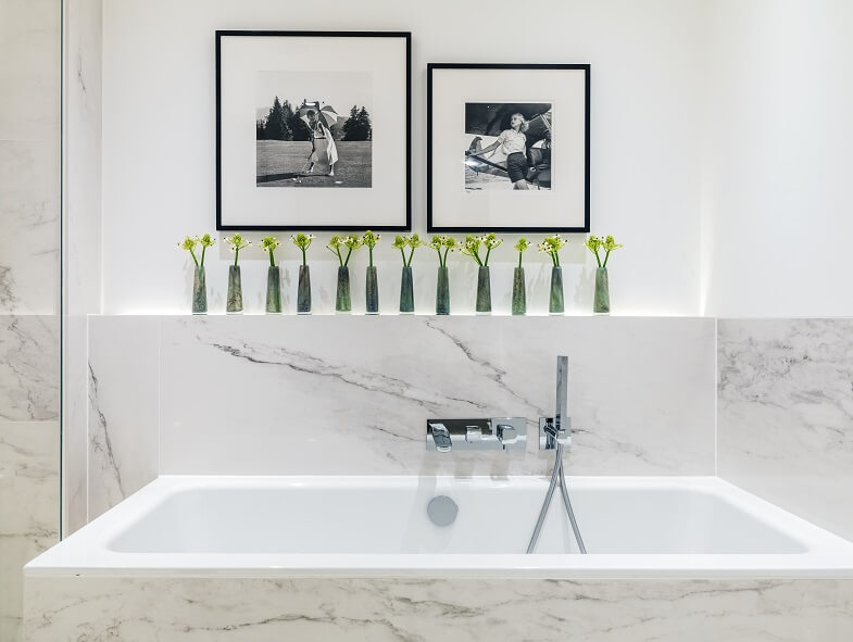 nature bathroom ideas,green plants above bathtub,marble bathtub walls,kelly hoppen bathrooms,luxury bathroom ideas,