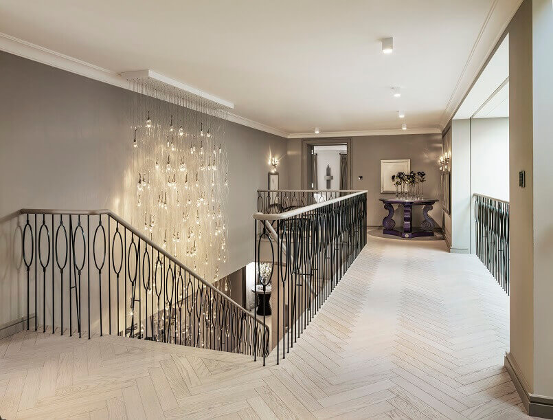 luxury chandelier corridor,kelly hoppen interior design projects,iron railing for stairs,luxury iron railing custom made,kelly hoppen interior design ideas,