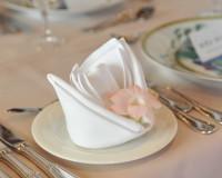 napkin folding for Christmas,festive napkin folding pattern,white napkin with flower,napkin folding for weddings,fancy napkin folding for weddings,