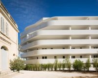 french architects contemporary,curved residential building,porcelain cladding exterior,italian porcelain tile brands,home design marseille,