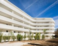 garden in front of apartment building,pietri architectes paris,casalgrande padana porcelain tile,contemporary architecture styles,curved architecture design,
