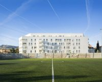 creative white architecture contemporary styles,soccer field in front of building,housing architecture design,white porcelain facade tiles outdoor,italian tiles for wall,