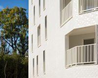 modern building facade materials,white color in architecture,contemporary apartment facade design,architecture offices in paris,casalgrande padana porcelain design,