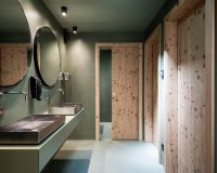 bathroom design inspired by nature,south tyrol lake recreation,wooden door in bathroom,bathroom dressing room design,double wash basin ideas for bathroom,