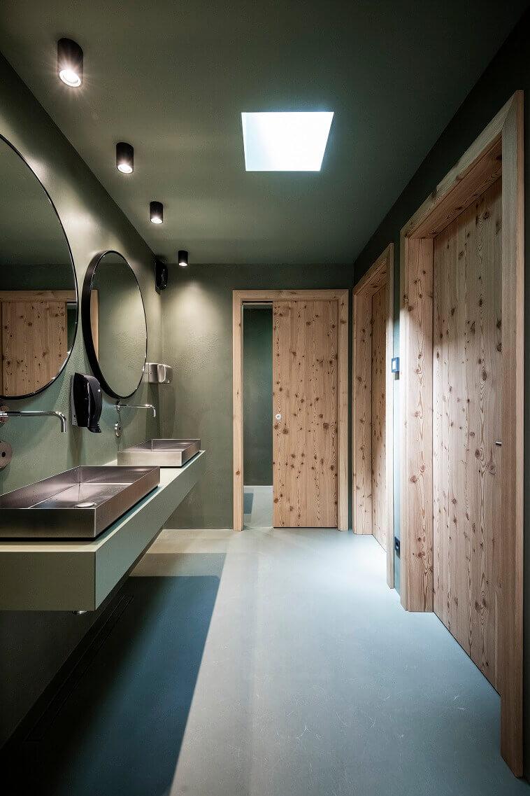 bathroom dressing room design,double wash basin ideas for bathroom,bathroom design inspired by nature,south tyrol lake recreation,wooden door in bathroom,