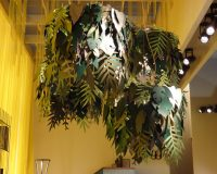 plants inspired ceiling lighting,yellow and green home color scheme,green leaf themed lampshade,natural interior design trends,creative lighting for dining room,