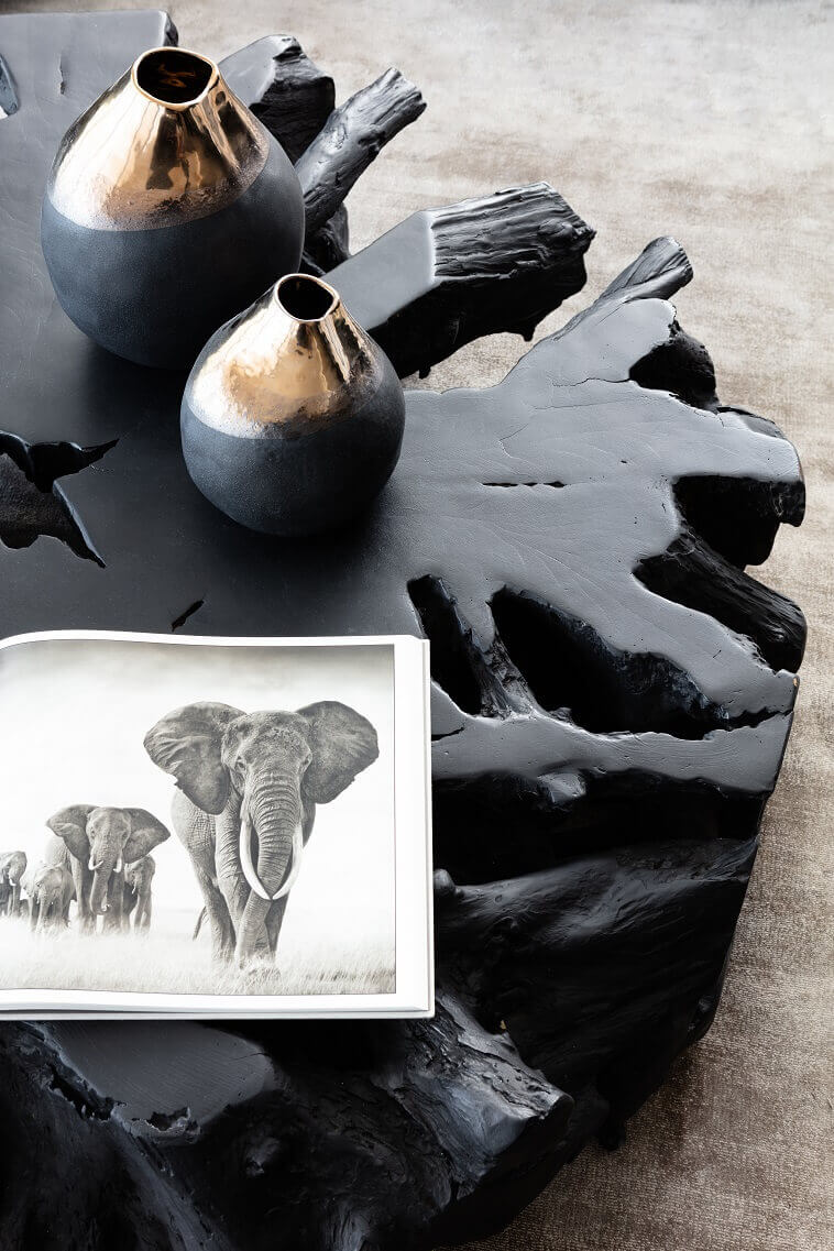 elephant photo living room,tree inspired furniture,tree trunk shaped coffee table,black and copper living room ideas,luxury living room decor,