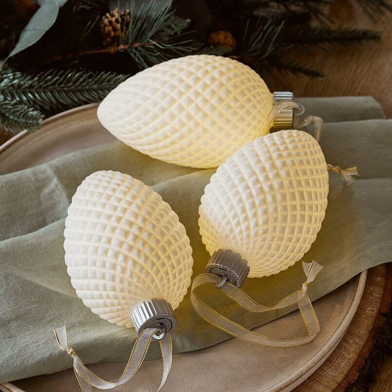 indoor festive Christmas lights,illuminated Christmas baubles,light up ceramic baubles,rustic holiday table settings,sparkling lights decoration ideas,