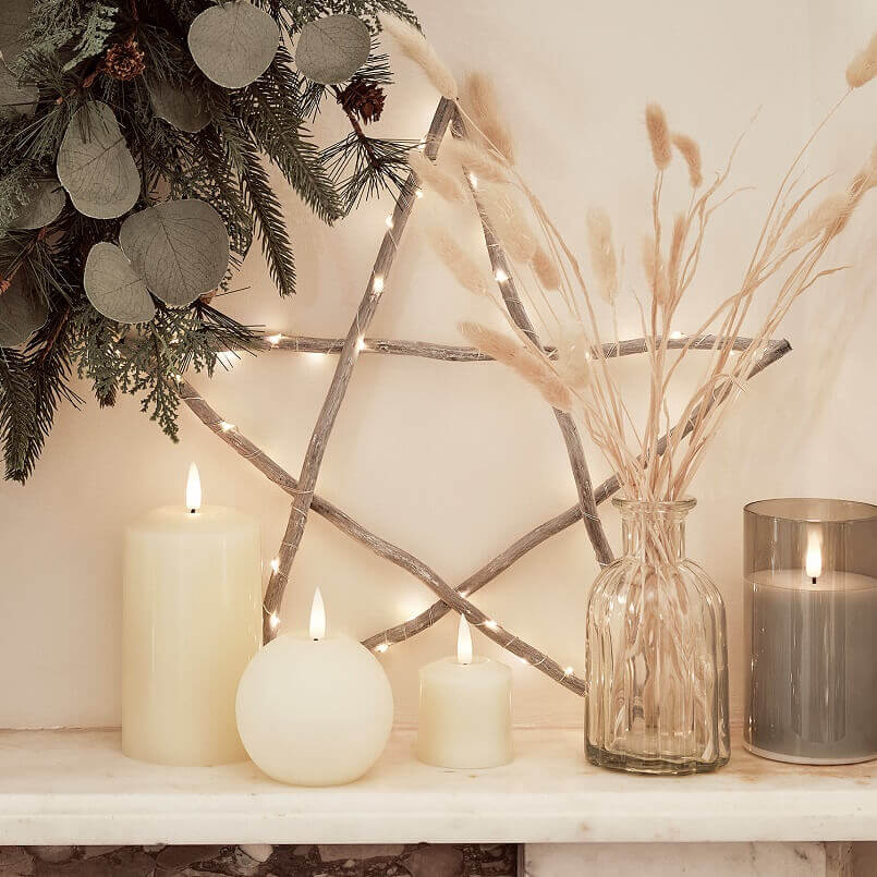 wooden star holiday decoration ideas,decorative star wall design,led candles for decoration,indoor festive Christmas lights,Christmas rustic home decor ideas,