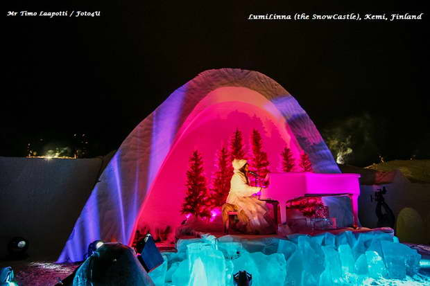 lumilinna snow castle kemi finland,ice hotel finland photos,stage made of ice,girl playing a piano,colorful light show,