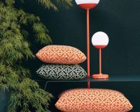 moon lamp fermob,red and white garden lamp,tristan lohner fermob,outdoor living space lighting,orange and black cushions,