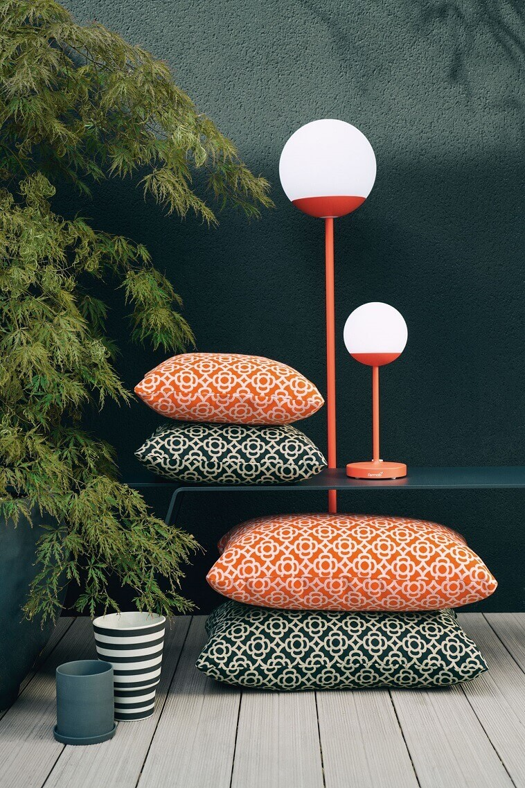 orange and black cushions,moon lamp fermob,red and white garden lamp,outdoor living space lighting,tristan lohner fermob,
