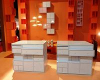 designer storage furniture,white and orange interior design,creative chest of drawers,trendy shelves wall,bookcases in living room designs,