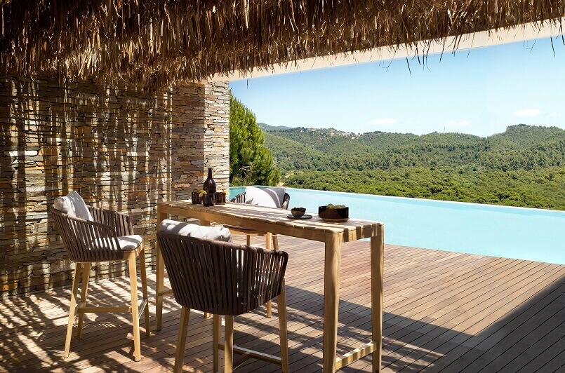 outdoor seating for a couple,design an outdoor dining space,tall dining table with tall chairs,wooden deck with pool,wooden outdoor furniture ideas,