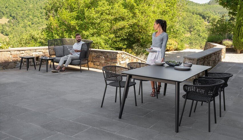 couple preparing lunch outdoors,modern outdoor dining room,designer outdoor dining furniture,talenti moon collection,cristian visentin designer,