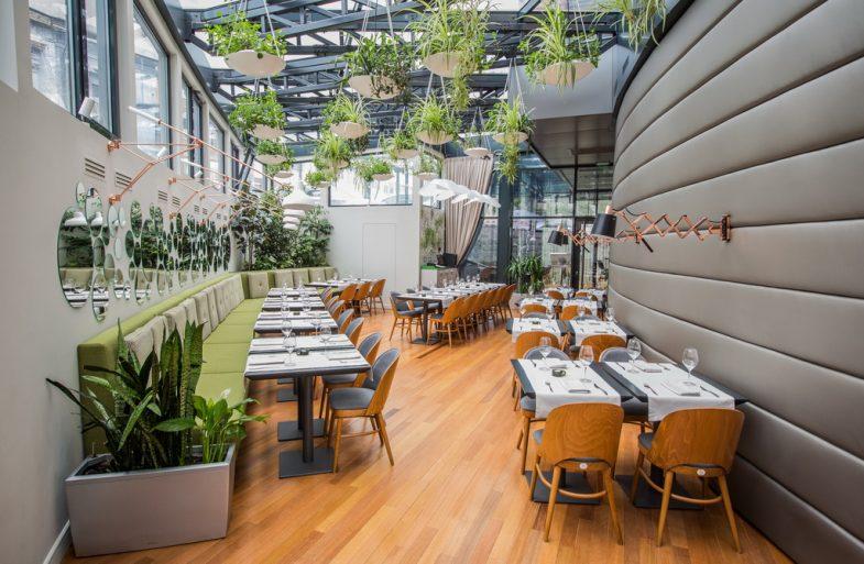 best restaurants in bucharest,greenery in restaurant designs,designer furniture for restaurant,pottery plants indoors,ceiling flower pot hangers,