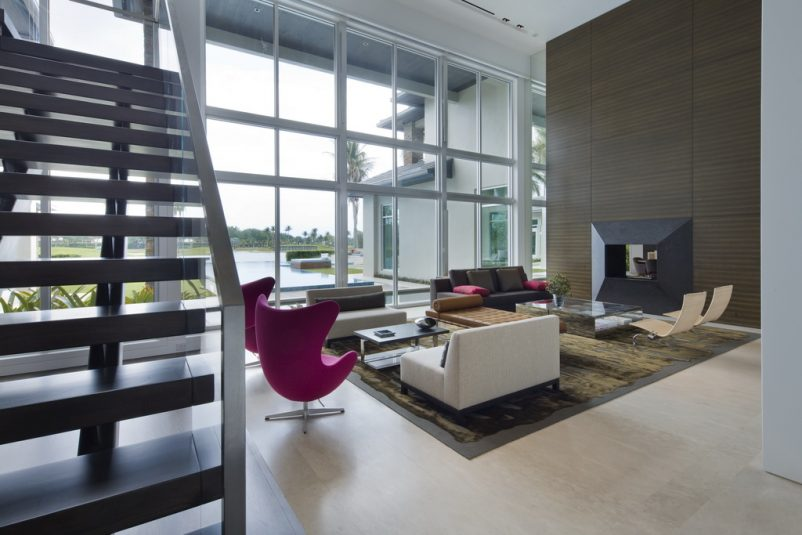 luxury architecture house design,modern glass house designs,pink lounge chair images,luxury homes in florida,large living room with fireplace,