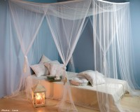 white blue bedroom decorating ideas,mediterranean style decor,white canopy bed,blue wall bedroom,large lantern decor,