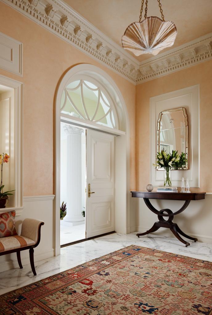 villa entrance interior design,luxury wooden console table with mirror,regency style interior decoration,pastel orange for home,florida luxury homes,