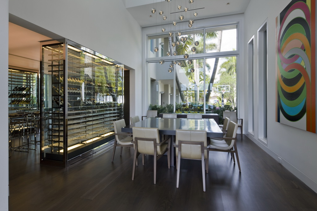 luxury dining room tables and chairs,large chandelier for dining room,wine rack glass cabinet,white designer dining chairs,dining room with garden view,