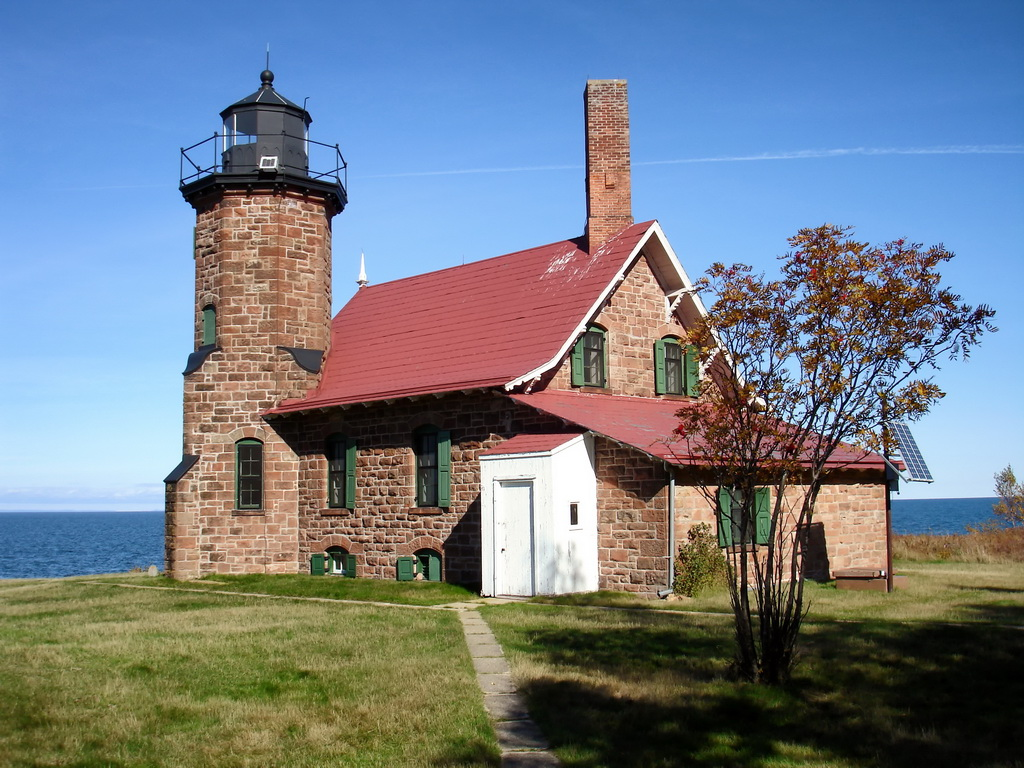 lighthouse design america,wood element feng shui personality,red brick house green windows,