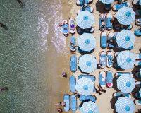 nammos mykonos,mykonos,Greece,Psarou Beach,beaches in Greece,sandy beach,famous beaches,sun loungers,parasol,parasol design,tuuci,restaurants,restaurant design,best restaurants,best restaurants in Greece,