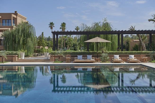 luxury hotels in morocco,mandarin oriental hotel marrakech,luxury lounge by the pool,luxury hotel design ideas garden,travel destinations morocco,