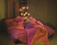 moroccan inspired bedding,colorful bedding sets for adults,moroccan inspired interior design ideas,exotic lighting fixtures,orange green purple bedroom ideas,