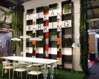vertical garden in office,creative conference room ideas,natural meeting room design ideas,grass carpet for office flooring,white and green workplace color scheme,