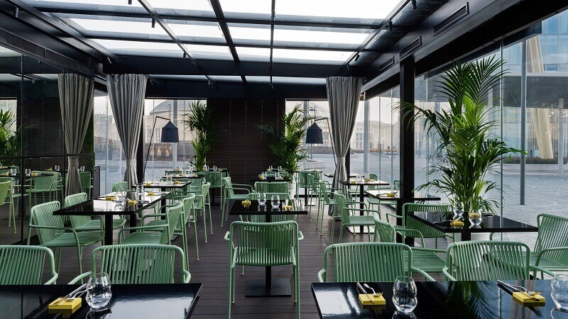 italian outdoor furniture brands,peck city life milano,green chairs in the dining room,green chair in restaurant design,restaurants in milan with a view,