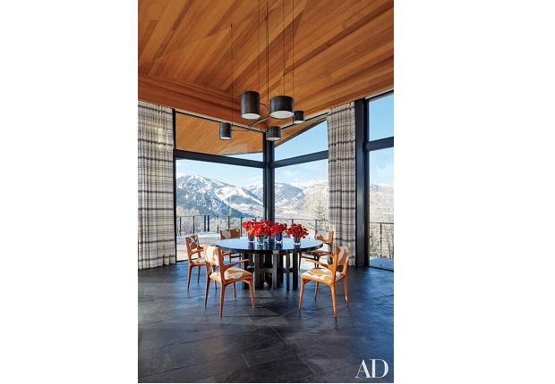 dining room with a mountain view,large windows in mountain house,high end wood dining chairs,winter interior design inspiration,high wooden ceilings,