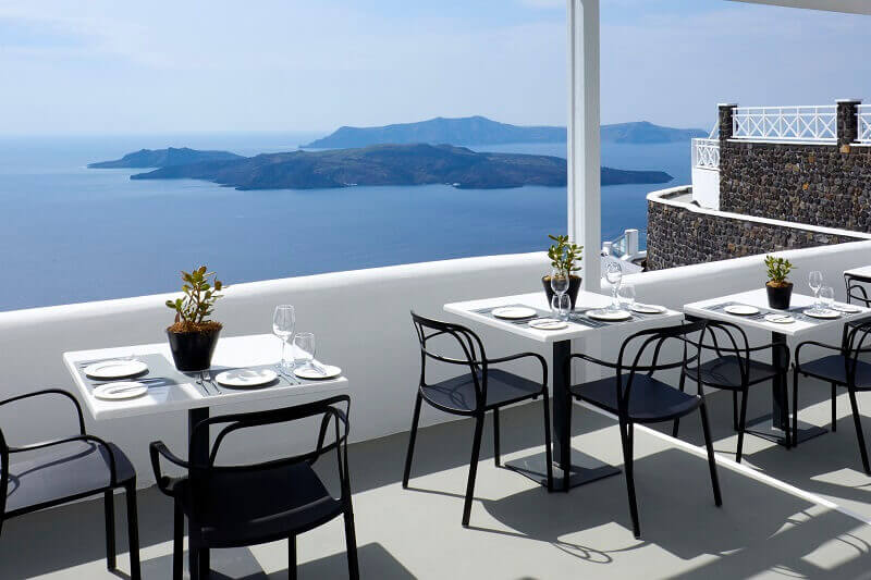 designer outdoor chairs dining,petit palace suites hotel santorini,luxury hotel terrace restaurant,small luxury hotels europe,terrace with a sea view santorini,
