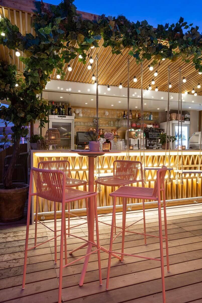 modern bar furniture design,restaurant plage la mandala cannes,orange chairs outdoor,restaurant terrace design ideas,pedrali chairs outdoor,