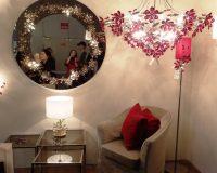 danica maricic interior designer,red floral chandelier,flower decorations for living room,flower themed mirror design,luxury brands lighting design,