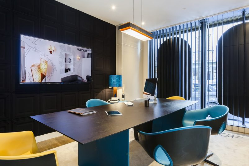 gray and blue office chairs,high end office design,luxury apartments paris,showroom design interior,blue and black workplace solutions,