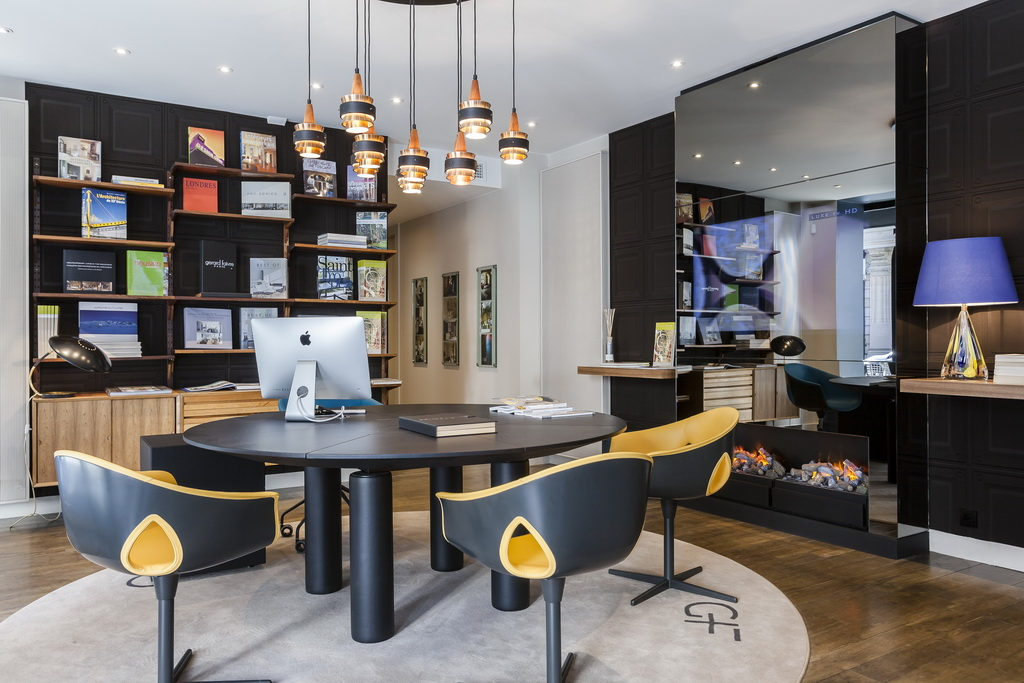 artistic meeting rooms,gray and orange office chairs,Gérard Faivre Paris art homes,high end office design,luxury homes france,